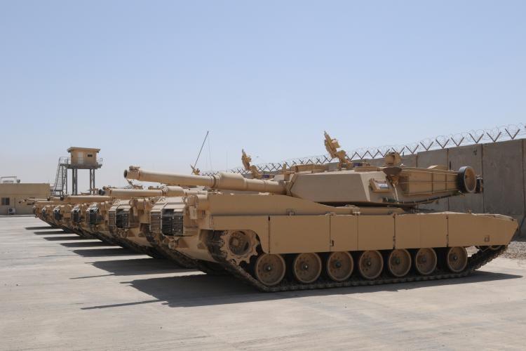 M1A1 Abrams tanks sit parked at a secured compound, Aug. 29, 2011. They're the last shipment of 140 M1A1 Abrams tanks that were part of a foreign military sales agreement with the United States.