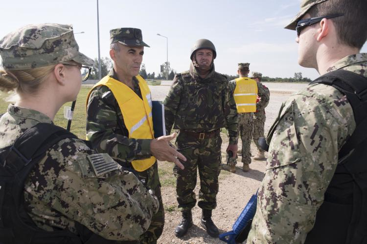 U.S. sailors collaborate with Romanian military service members during Exercise Shieldex 18 in Deveselu, Romania, July 18, 2018.