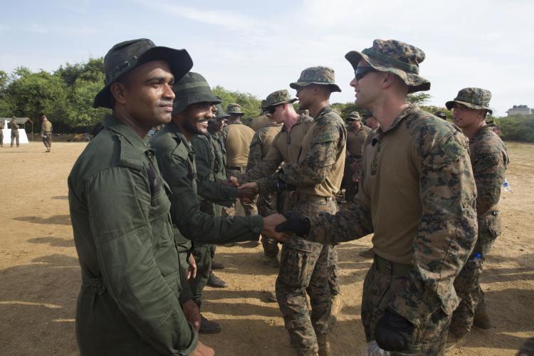 As part of a security cooperation effort, Sri Lanka Navy Marines meet and shake hands with U.S. Marines and sailors, Aug. 25, 2018.