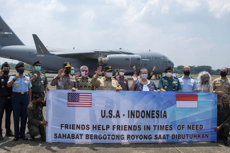 U.S. and Indonesian personnel welcome the arrival of 500 ventilators.