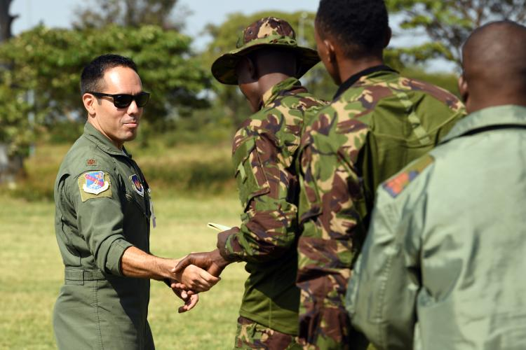 A U.S. Air Force officer shakes hands with a soldier from an allied nation. The Defense Security Cooperation Agency works with State Department officials to promote civilian protection in both foreign military sales and security cooperation. These efforts include expanding training for U.S. allies and partner nations as well as providing additional advisory support with a specific emphasis on mitigation of civilian harm.